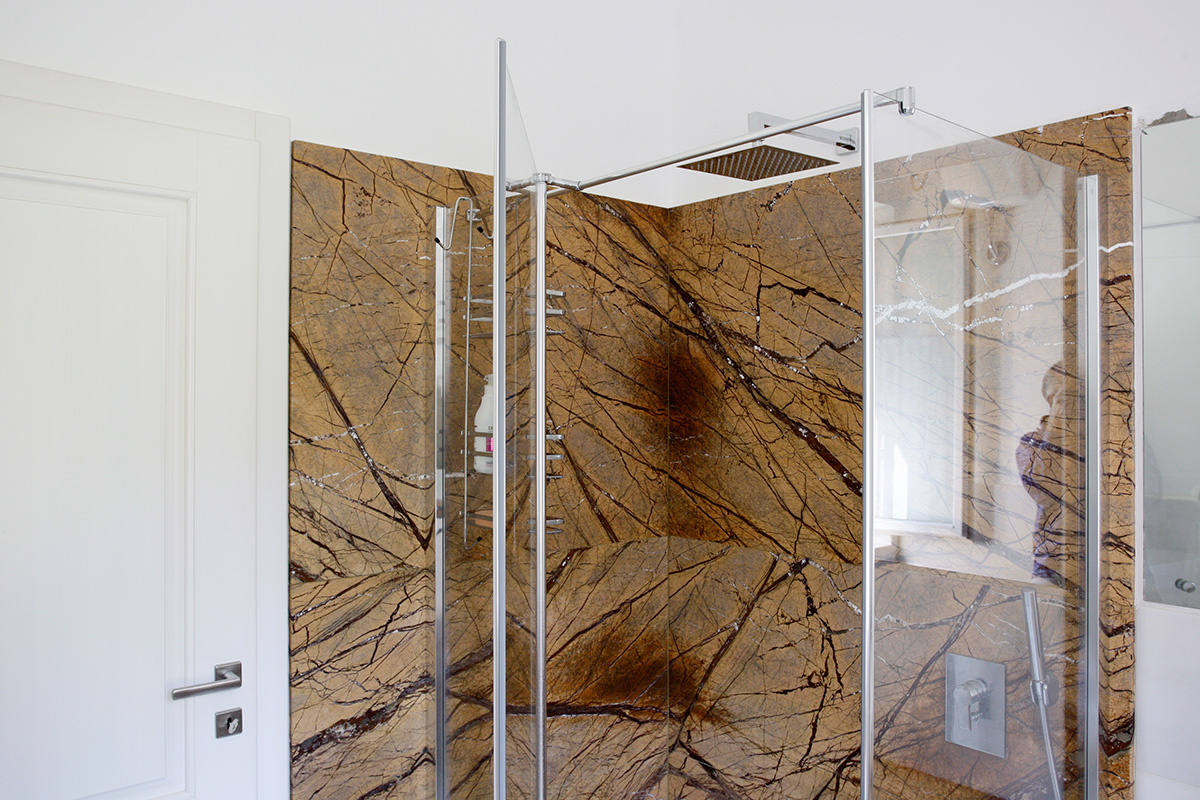 Shower enclosure single slab yellow/gold marble